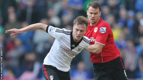 Ben Turner (right) in action against Fulham's Cauley Woodrow