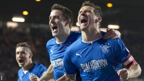 Rangers captain Lee McCulloch celebrates the League One title win