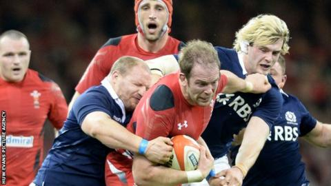 Two Scottish defenders grapple with Wales' Alun Wyn Jones