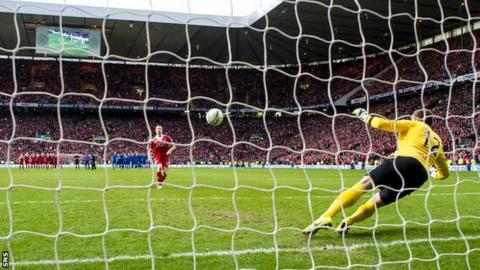 Adam Rooney scores the penalty that wins the Scottish League Cup for Aberdeen