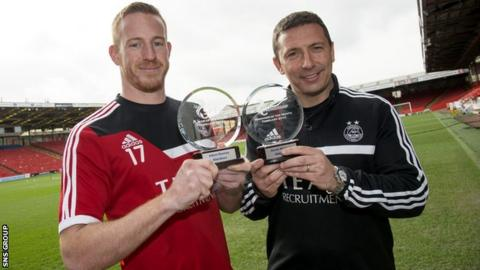 Adam Rooney and Derek McInnes (right) show off their awards