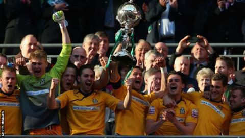 Cambridge United celebrate with the FA Trophy