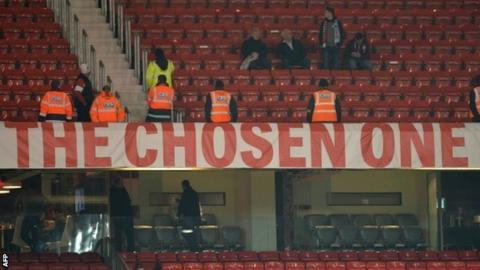 Stewards guard the Chosen One banner at Old Trafford on Tuesday