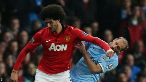 Marouane Fellaini (left) and Pablo Zabaleta