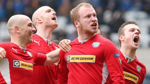 Liam Boyce celebrates with teammates after scoring