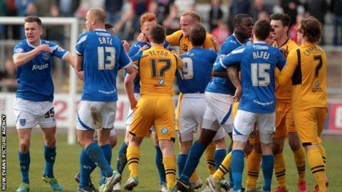 A poor tackle from Adam Chapman, which saw the Newport man sent off, spark a melee with the Portsmouth players