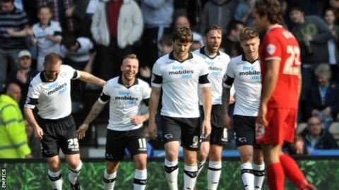 Derby County players celebrate Johnny Russell's goal