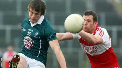 Patsy Bradley attempts to block at Padraig Brophy shot