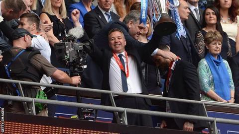 Peterborough United manager Darren Ferguson holds the Johnstone's Paint Trophy