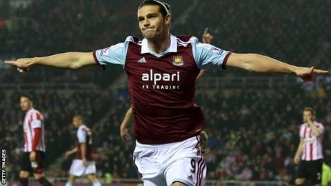 Andy Carroll celebrates scoring against Sunderland