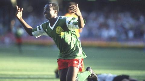 Roger Milla celebrates after scoring for Cameroon against Colombia