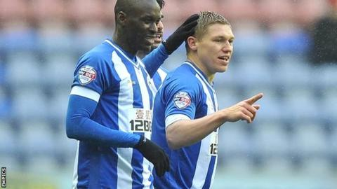 Wigan's Martyn Waghorn (right) celebrates