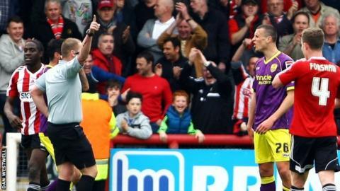 Referee Charles Breakspear sends off Notts County defender Haydn Hollis