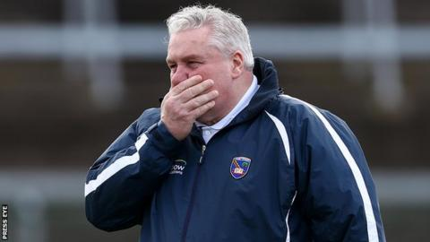 Paul Grimley watches his Armagh side suffering relegation to Division 3 of the Football League