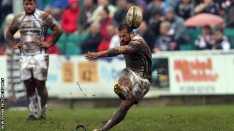 Simon Humberstone kicks the winning penalty
