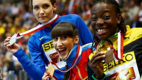 "Medallists Ukraine's Saladukha Russia's Koneva and Jamaica's Williams celebrate after women""s triple jump final at world indoor athletics championships in Sopot"