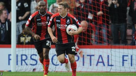 Ryan Frazer (right) turns away after scoring form Bournemouth