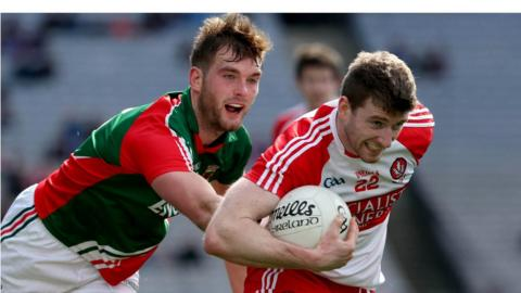 Derry's Niall Holly tries to escape the clutches of Aidan O'Shea in a keenly contested last four clash
