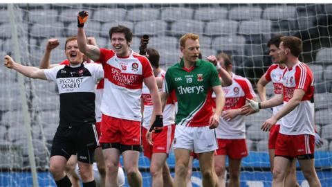 Karl McKaigue leads the Derry celebrations after the final whistle at Croke Park