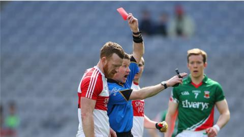 Referee Padraig Hughes sends off Fergal Doherty during the first half of the League semi-final