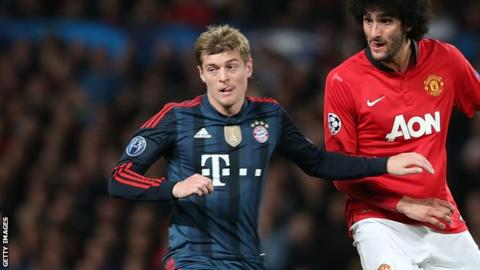 Toni Kroos and Marouane Fellaini
