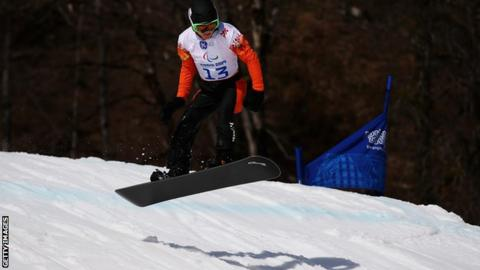 Chris Vos of the Netherlands competes during the Men's Para Snowboard Cross Standing