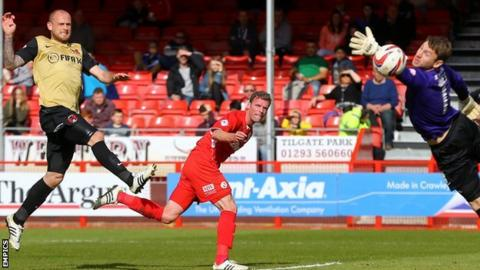 Crawley Town's Andy Drury heads his side's winner past Leyton Orient goalkeeper Jamie Jones