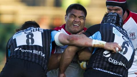 Nick Williams is tackled by two Glasgow players