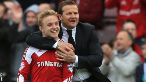 Alex Pritchard and Swindon manager Mark Cooper