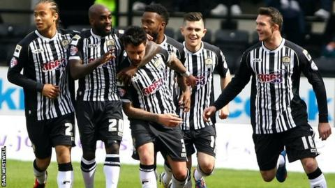 Alan Sheehan celebrates with Notts County team-mates
