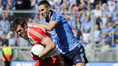Mark Lynch attempts to break away from James McCarthy at Croke Park