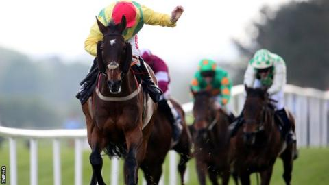 Andrew Lynch rides Sizing Europe to victory in Tuesday's Champion Chase