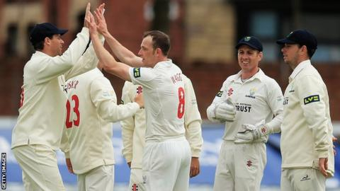 Graham Wagg of Glamorgan is congratulated on the wicket of Ned Eckersley of Leicestershire, after he was bowled during day one of the LV County Championship match