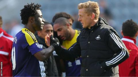 Swansea coach Garry Monk and striker Wilfried Bony shake hands after a match