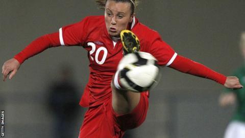 Natasha Harding controls a high ball while playing for Wales