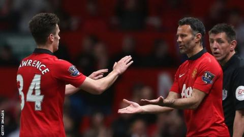 Tom Lawrence greets Ryan Giggs as he is replaced following his first team debut for Manchester United