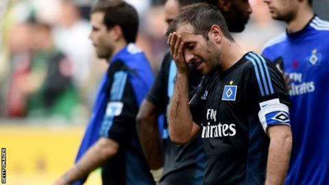 Dejected Hamburg players