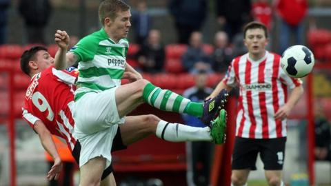 Enda Curran of Derry City challenges Shamrock Rovers opponent Conor McKenna at the Brandywell