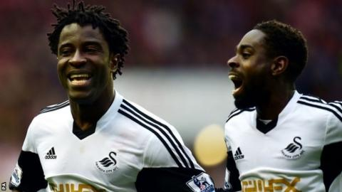 Wilfried Bony (l) and Nathan Dyer celebrate Swansea's third goal