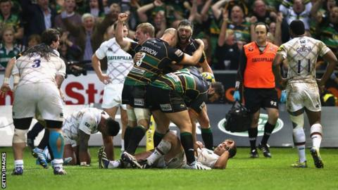 Northampton celebrate Tom Wood's late try