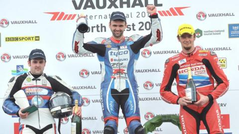 Michael Dunlop had to settle for second as his brother William celebrates victory after a thrilling first Superbike race - Conor Cummins completes the podium