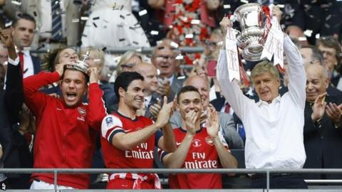 Arsenal managerArsene Wenger lifts the FA Cup