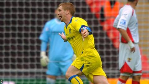 Barrow's Jason Walker celebrates scoring his sides second goal of the game in the FA Trophy final with Stevenage