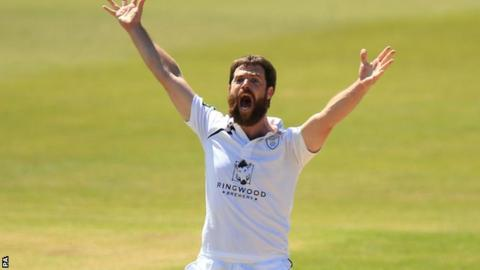 James Tomlinson takes a wicket for Hampshire