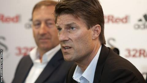 Laudrup with Huw Jenkins in the background