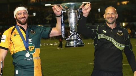 Tom Wood and Jim Mallinder lift the Amlin Challenge Cup for Northampton Saints