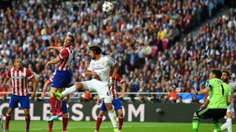 Diego Godin scores for Atletico Madrid to put them one nil up after Iker Casillas makes a bad decision to come for the ball