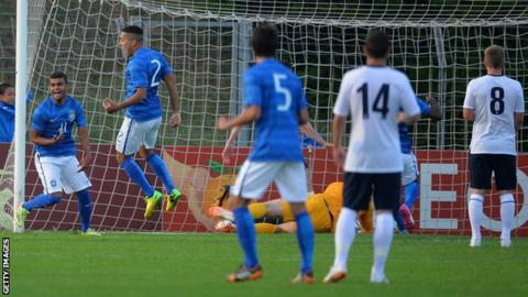 Alisson celebrates after scoring Brazil's first goal against England Under-20s in the Toulon Tournament.