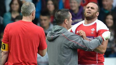 Centre Jamie Roberts gives Wales coach Warren Gatland a scare in the trial match as he leaves the pitch with a shoulder injury.