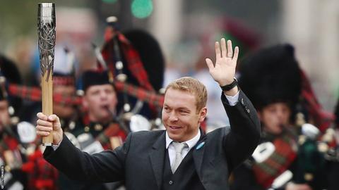 Sir Chris Hoy with the Queen's Baton